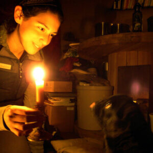 woman holding candle, having gone electricity free
