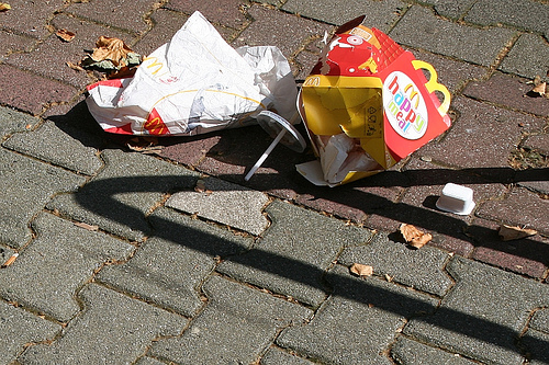 Happy Meal littering the sidewalk