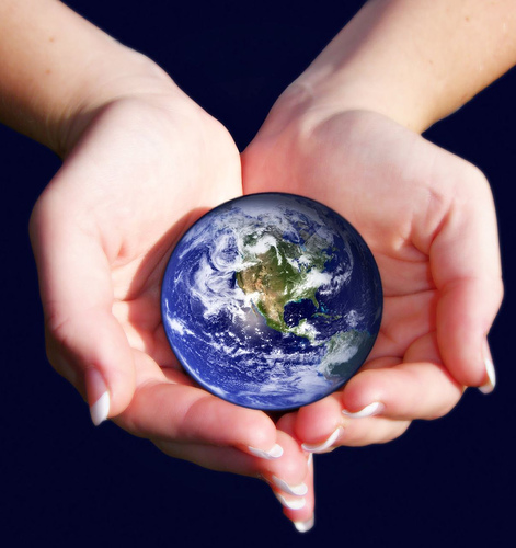 A pair of hands cradles the Earth