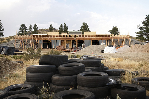 Building with tires: an earthship under construction in wheatland, wyoming