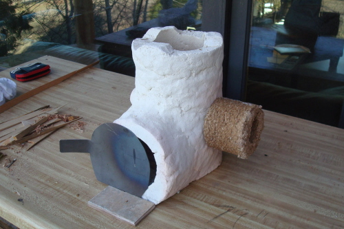 holey rocket stove for cooking with biomass briquettes