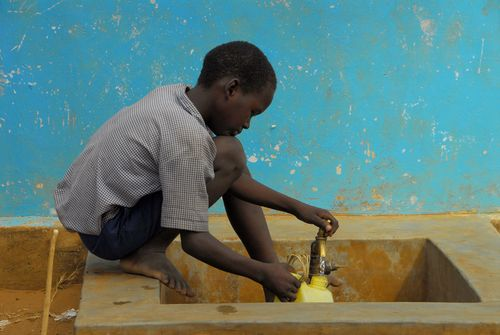 Boy stocks drinking water in Kenya