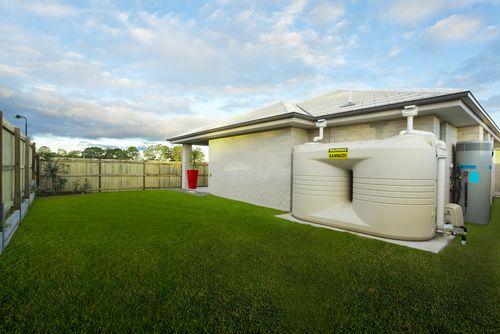Backyard rainwater collection tanks