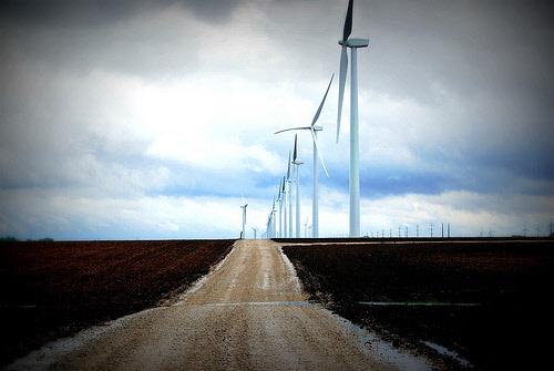 wind turbines along a dirt road