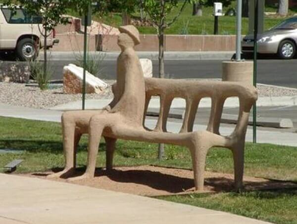 cement person molded into bench