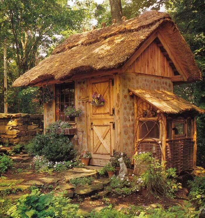 Whimsical Thatched Potting Shed with Rabbit Hutch on Side