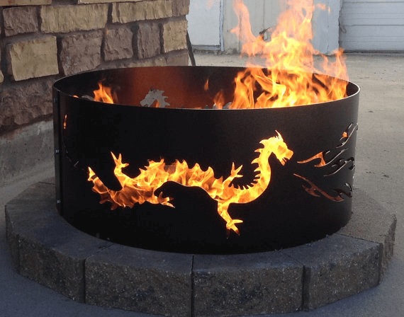 Dragon Fire Pit. Dragons and flames seem like a natural match. Photo via  NunnakhovenArtStone. - Metal Fire Pits • Insteading