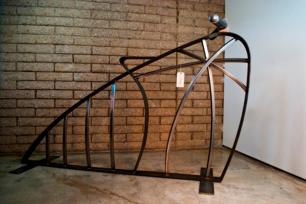 Another one for sale on etsy from Voigt Metal, this futuristic bike sculpture doubles as a bike rack.