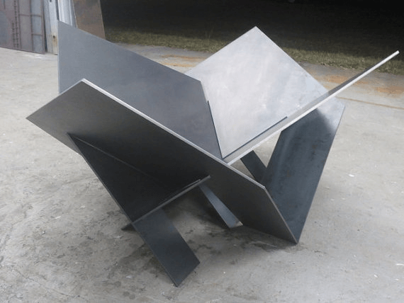If you want an industrial look, this shiny steel piece will fit right in at any warehouse. Photo via LethalFabrication.