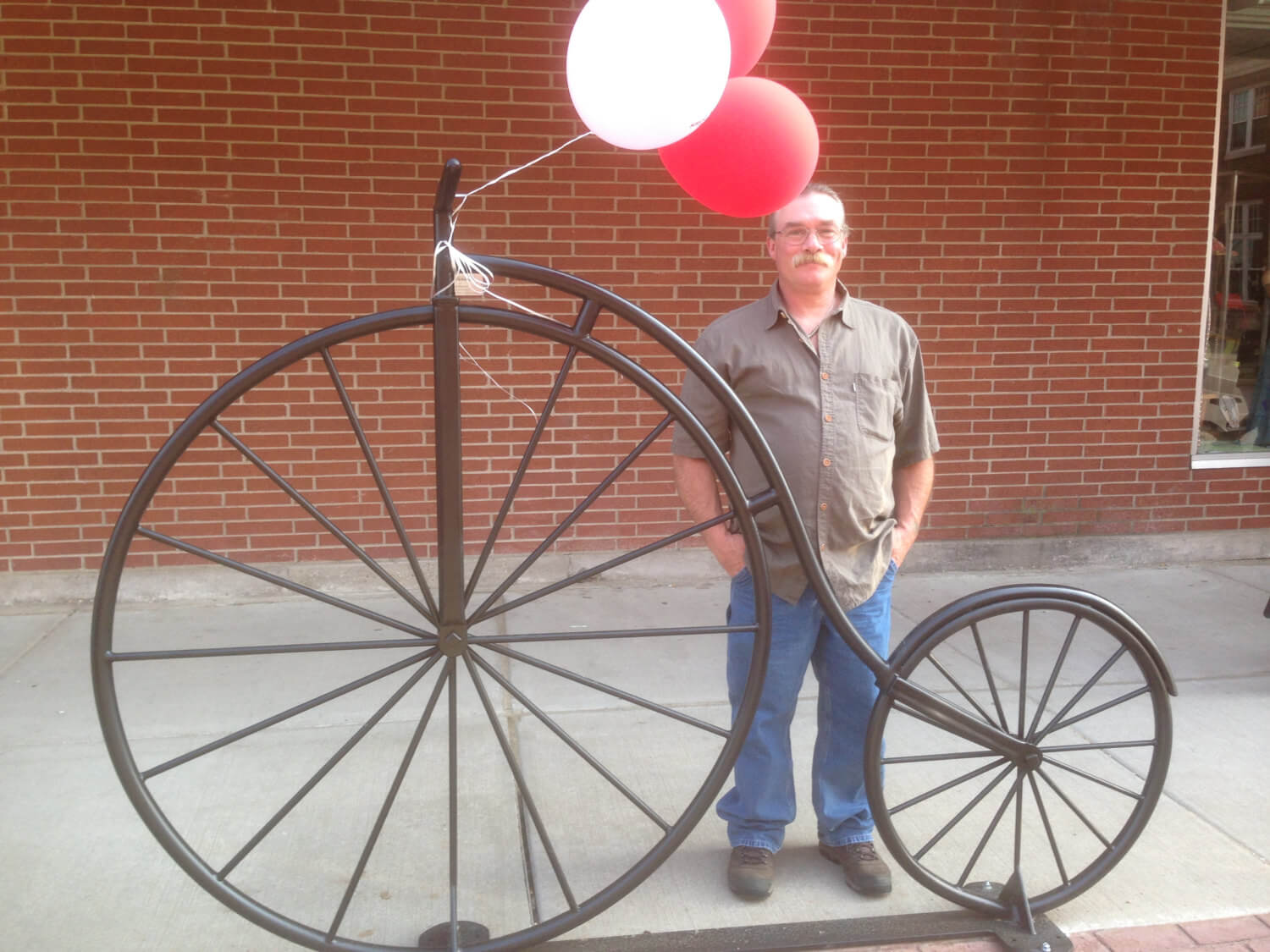 This classic vintage bike rack was made for the city of PLatteville, Wisconsin, and similar versions can be bought through the metal artist on etsy.com.