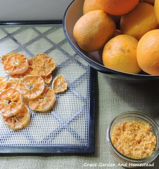 dehydrator recipes: dehydrated orange slices, powder, and a bowl of oranges