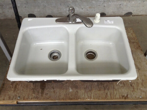 a salvaged kitchen sink selling for just 20 bucks