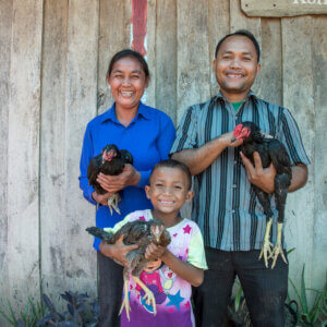 Heifer International -Cambodia, December 2015. Income II Project. Klang Savuth (43) (left), Kid Moa (43) and their son Ky Damkoeung (6) pose for a photo outside their home on December 08, 2015 in Kok Romeat Village, Cambodia.