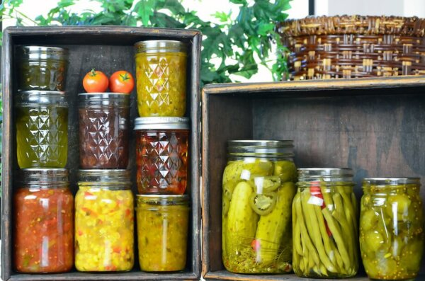 Jars of home canned vegetables in wooden boxes