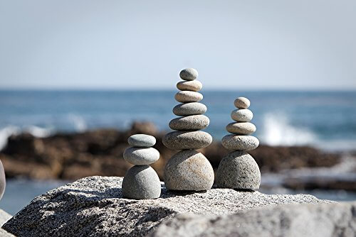 natural river stone rock cairn insteading