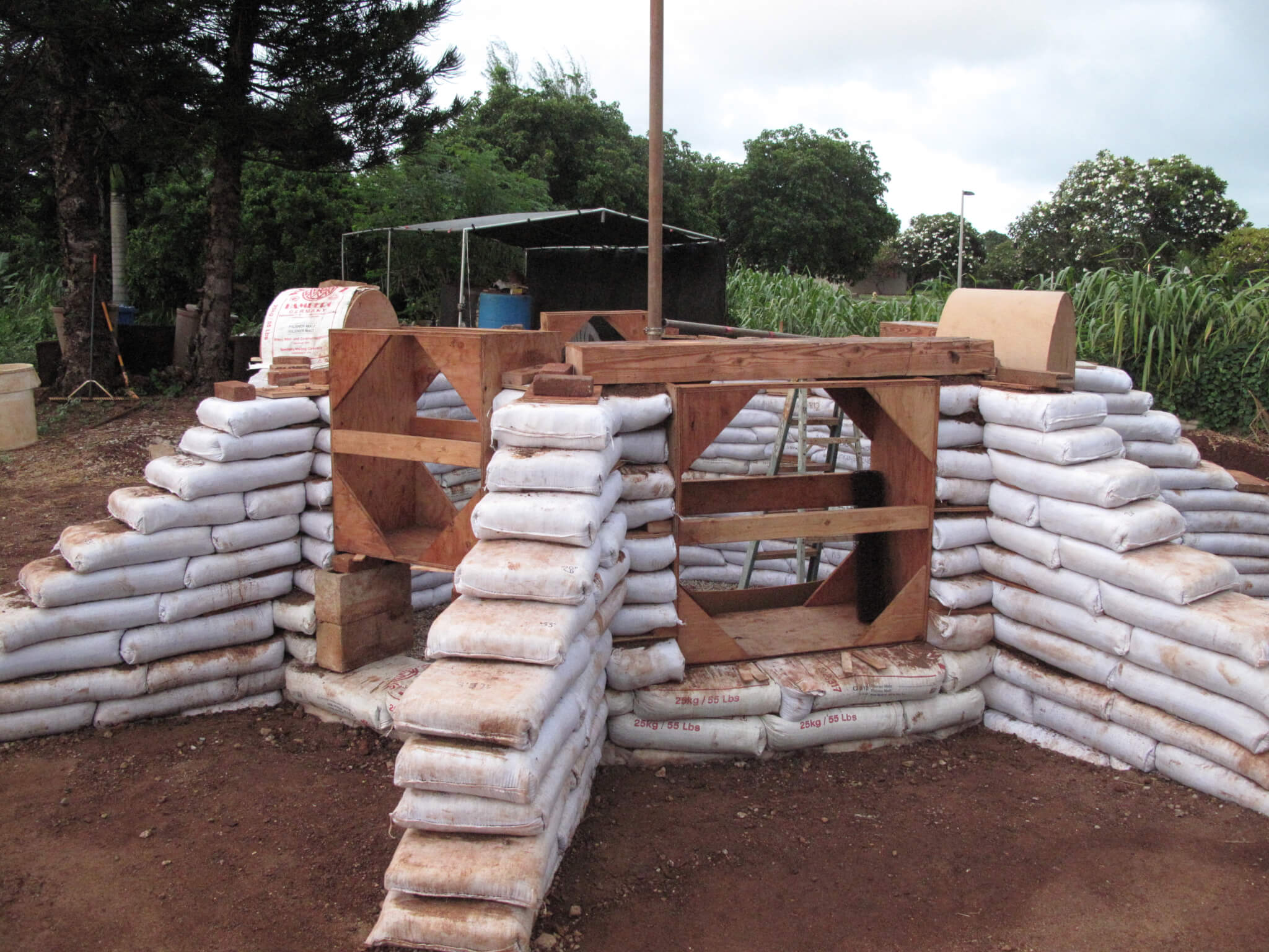 earthbag dome with buttresses and lintels in place