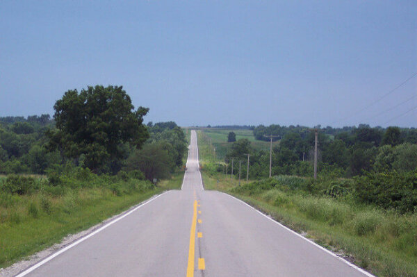 A road stretches into the distance without an end in sight.