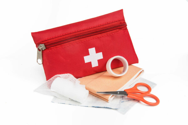 first aid kit with scissors and dressings