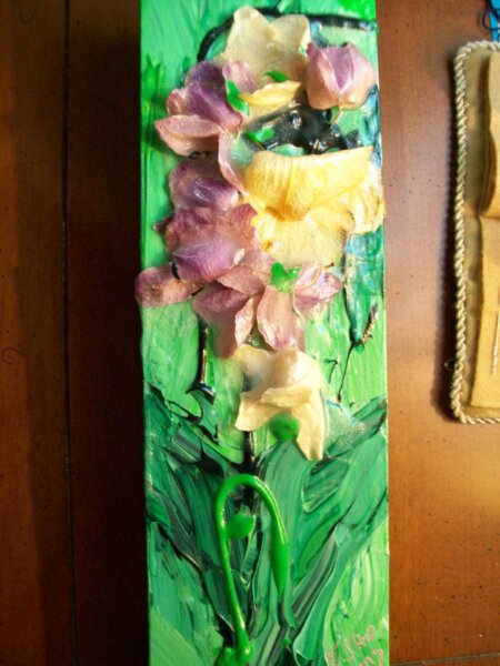 orchid preserved in green paint on canvas