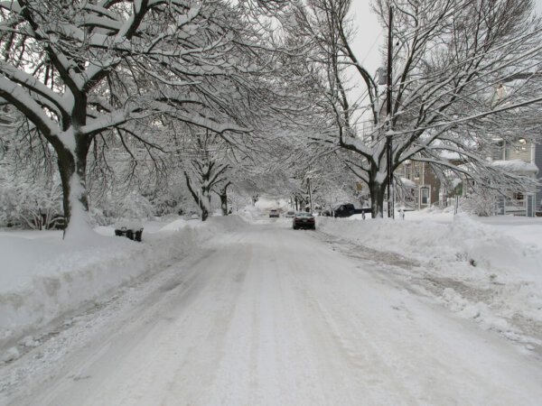 residential road covered in snow