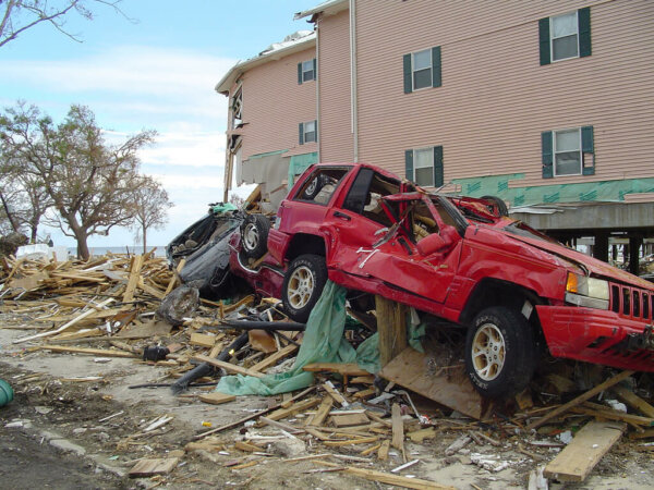 natural disaster aftermath with crushed car