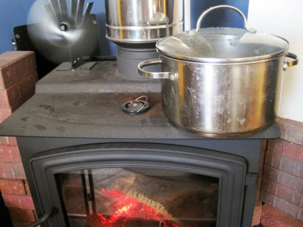 pot leaching acorns on wood burning stove