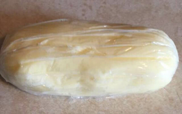 butter finished and wrapped in plastic