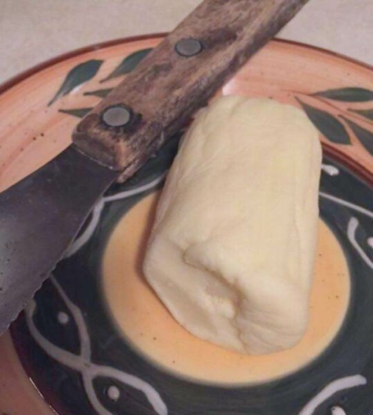 homemade butter on dish with knife