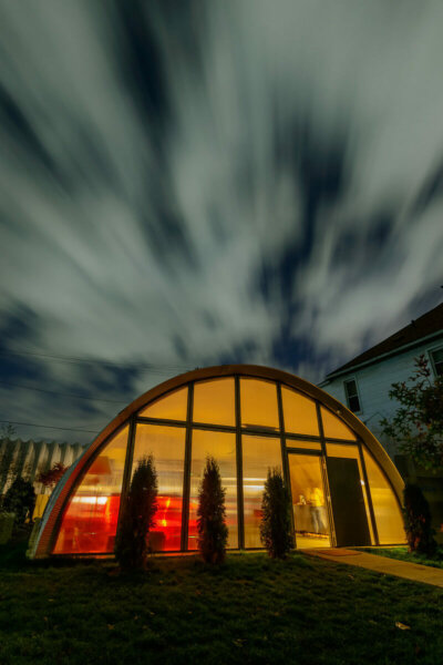 quonset hut home at sunset
