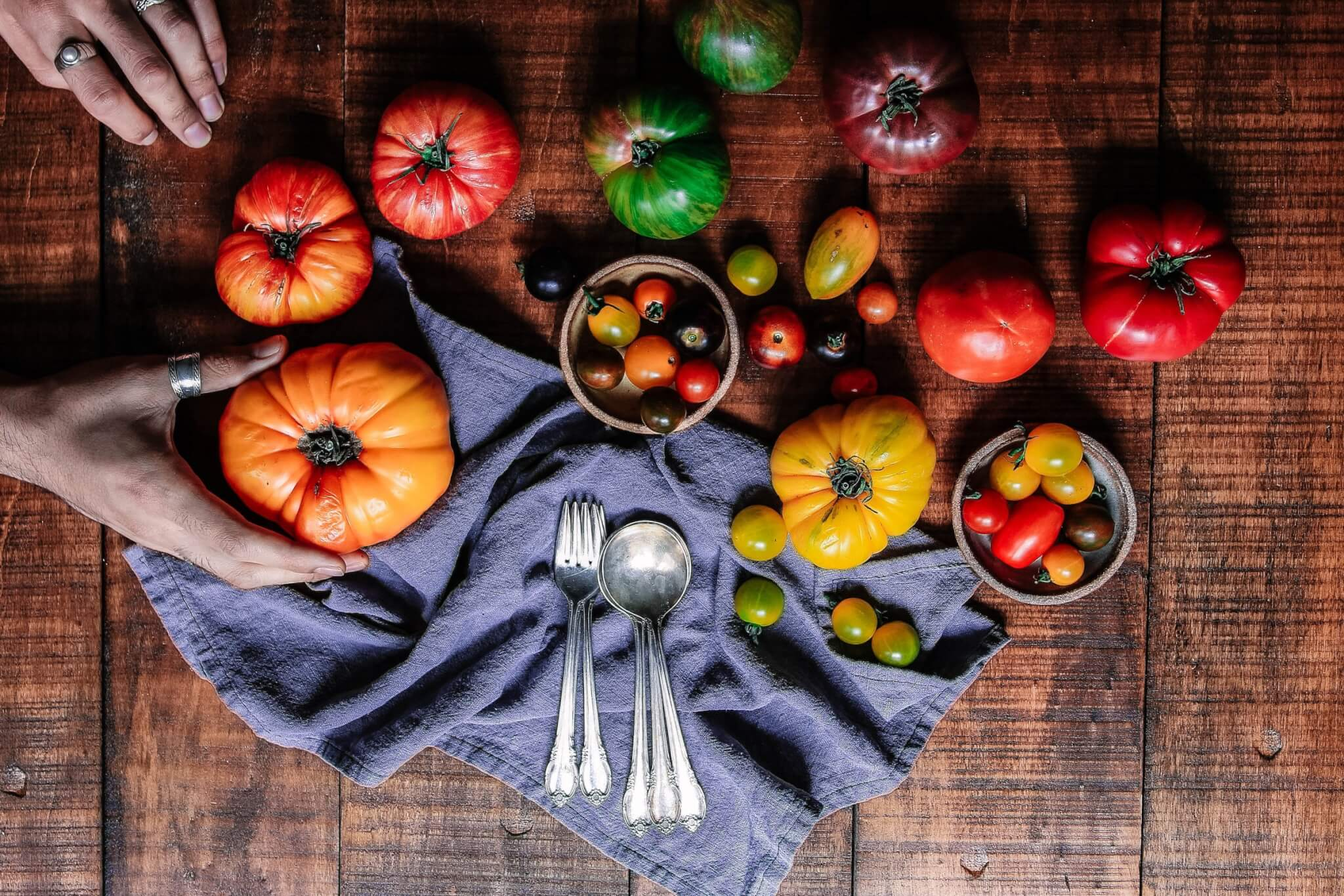 tomatoes on table with utensils