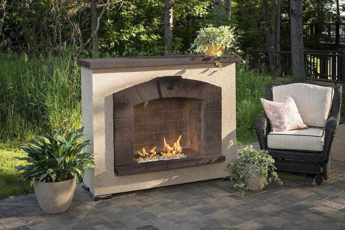 Stucco Finish Stone Arch Fireplace