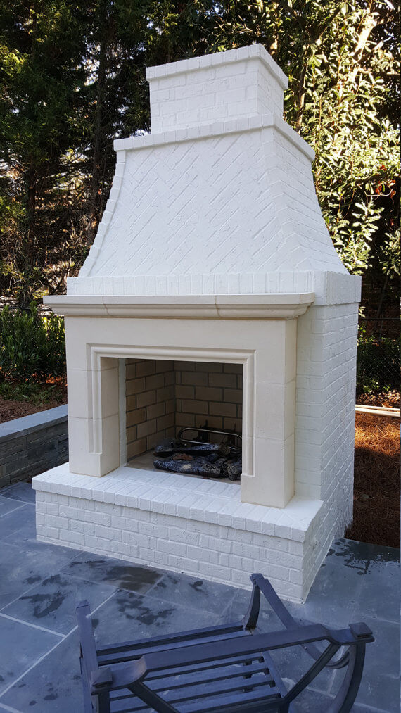 White Cast Stone Fireplace