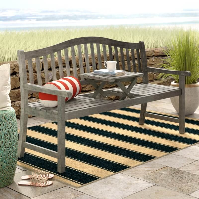 rustic outdoor bench with pop up table