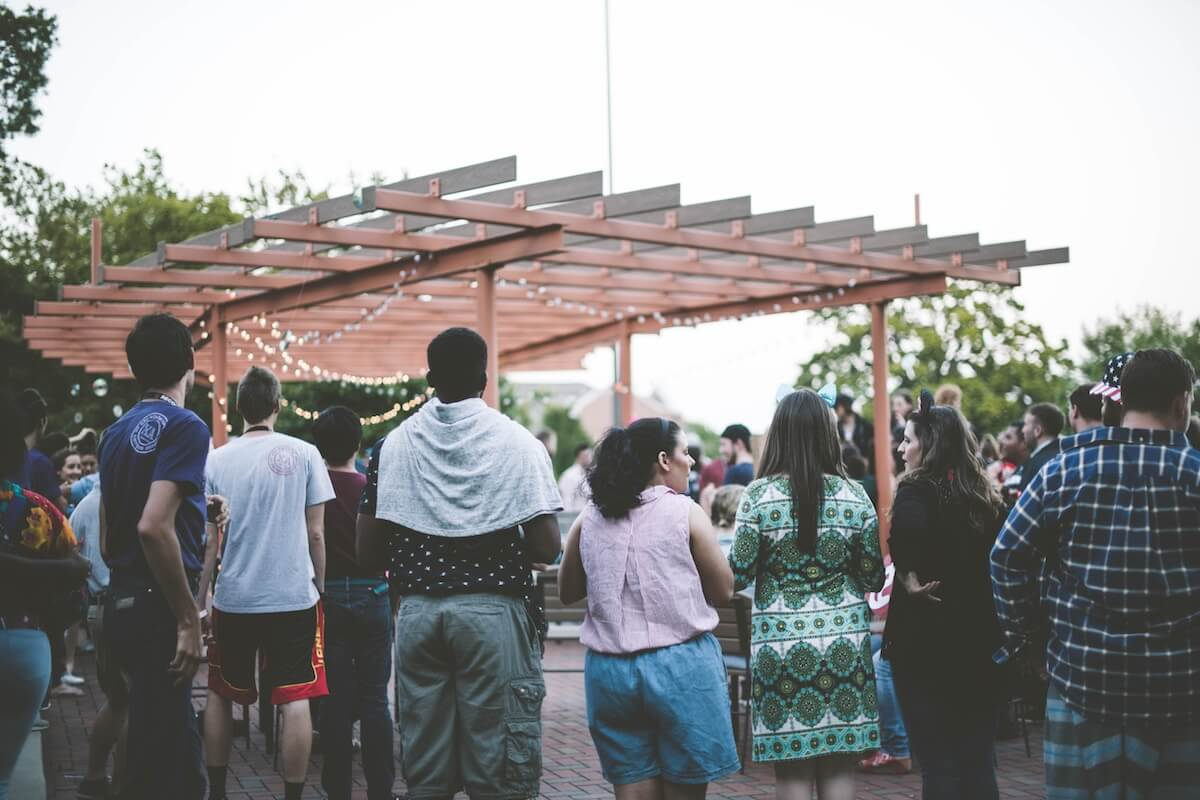 people standing around pergola