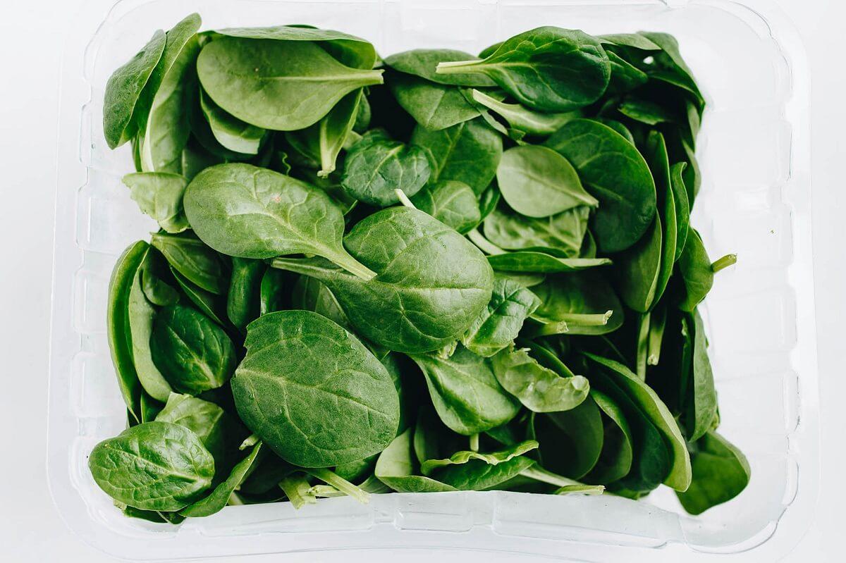 spinach in a clear bin