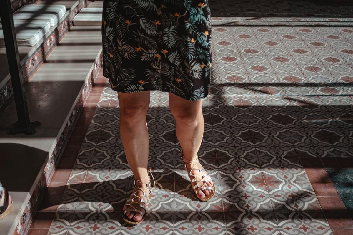 women standing on ceramic tiles