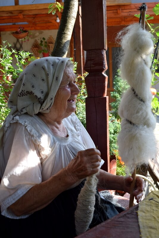 woman with wool spools