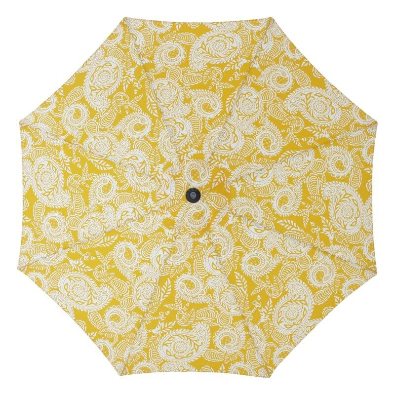 white and yellow paisley umbrella