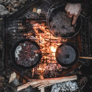 camping on a dutch oven over fire