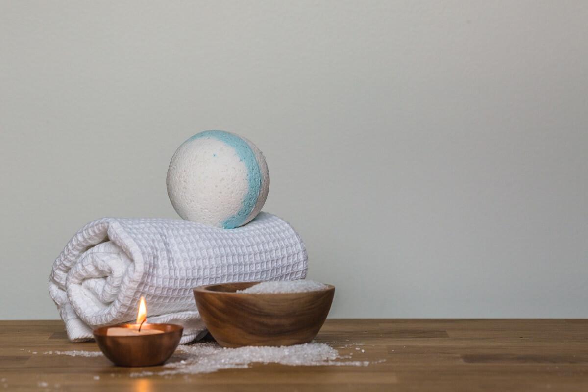 epsom salt, towel, candle, and bath bomb