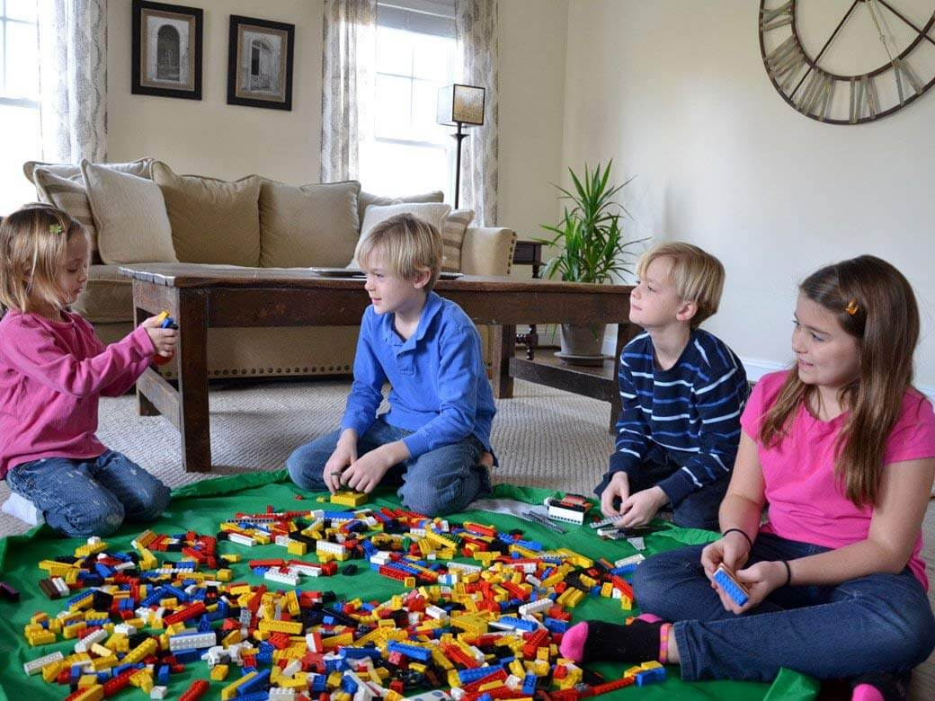 kids playing with legos on play mat