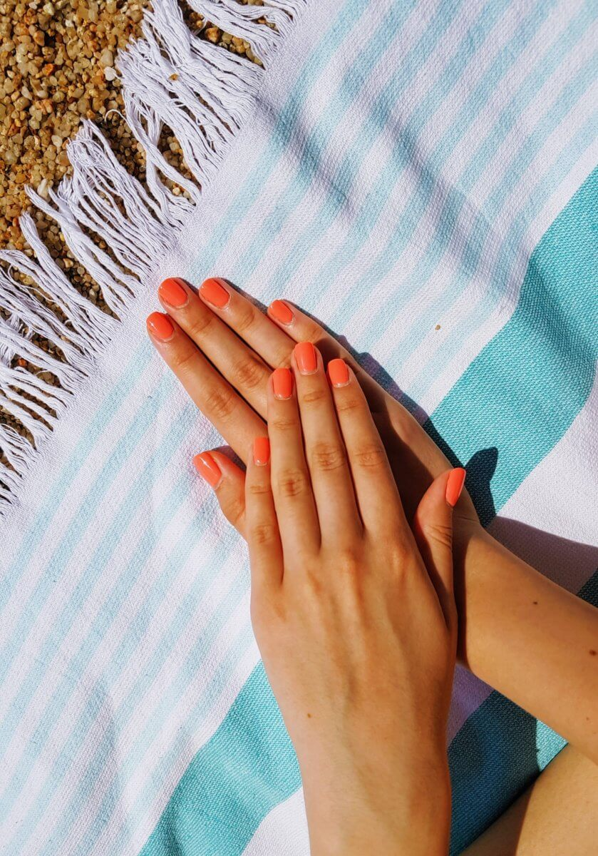 painted nails on top of blanket