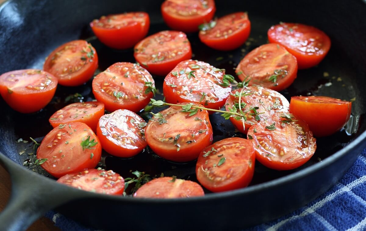 tomatoes cooking in cast iron