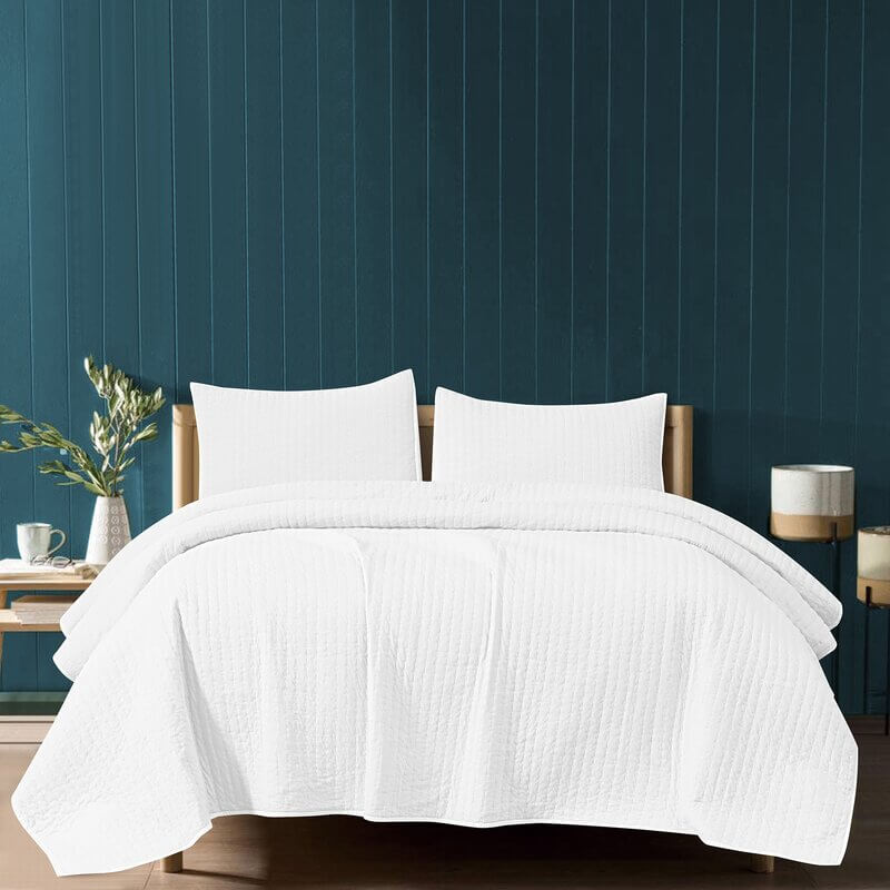 white linens and blue wall