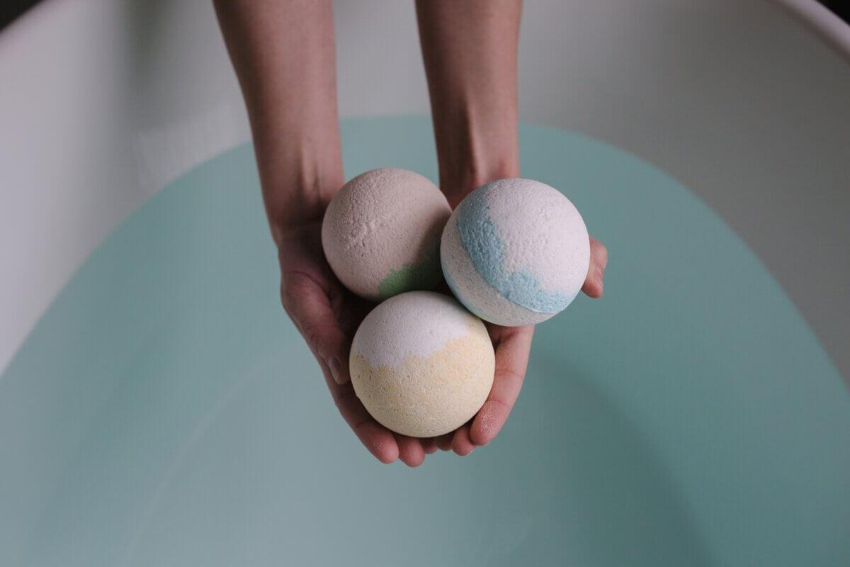 tossing DIY bath bombs in tub