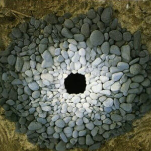 circle of stones, darkest on the outside, lightest toward the center