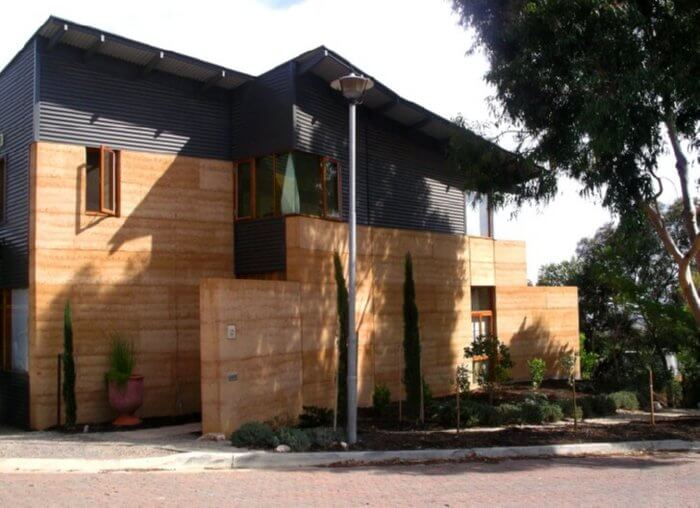 Rammed Earth • Insteading on compressed earth block homes, modern earth sheltered homes, earth cement floors in homes, modern ranch style house designs, earth natural built homes, modern home design,